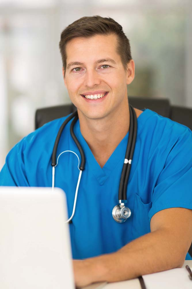Respiratory Care - male nurse working on laptop computer